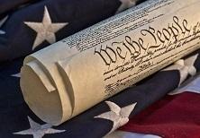 ConstitutionRolledUpOnFlag-500px_shutterstock_102137239-500x346