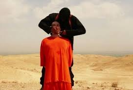 ISIS beheads a captive 2014