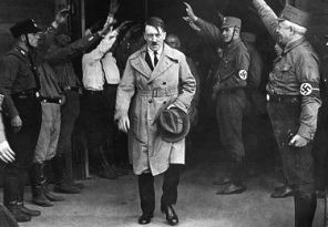 Adolf Hitler, leader of the National Socialists, emerges from the party's Munich headquarters on December 5, 1931.  Hitler predicted his Nazi party would one day control Germany. (AP Photo)